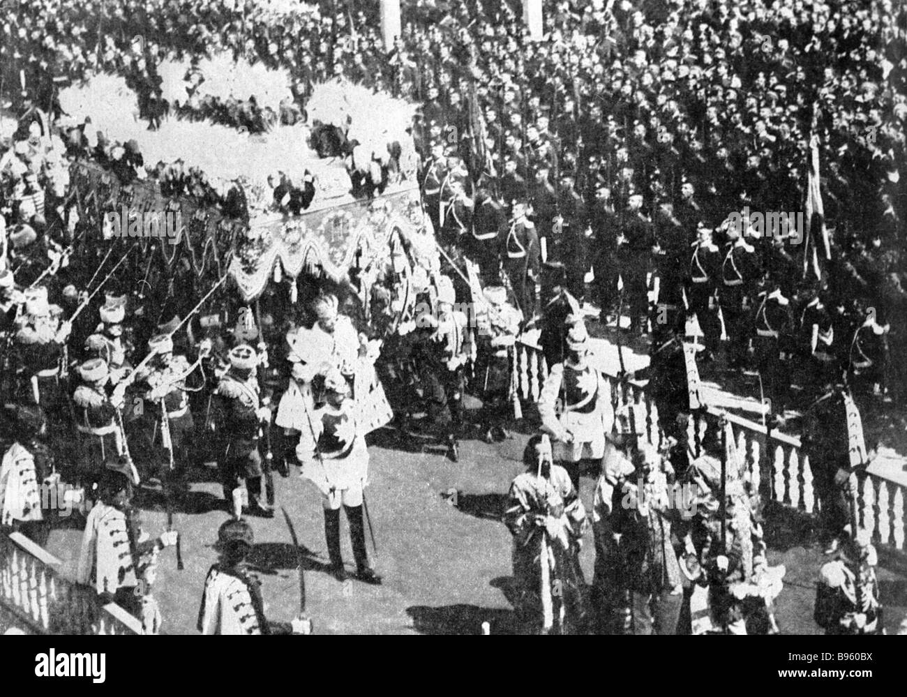 Emperor Nicholas II with the regalia under a canopy in a Kremlin procession - Stock Image