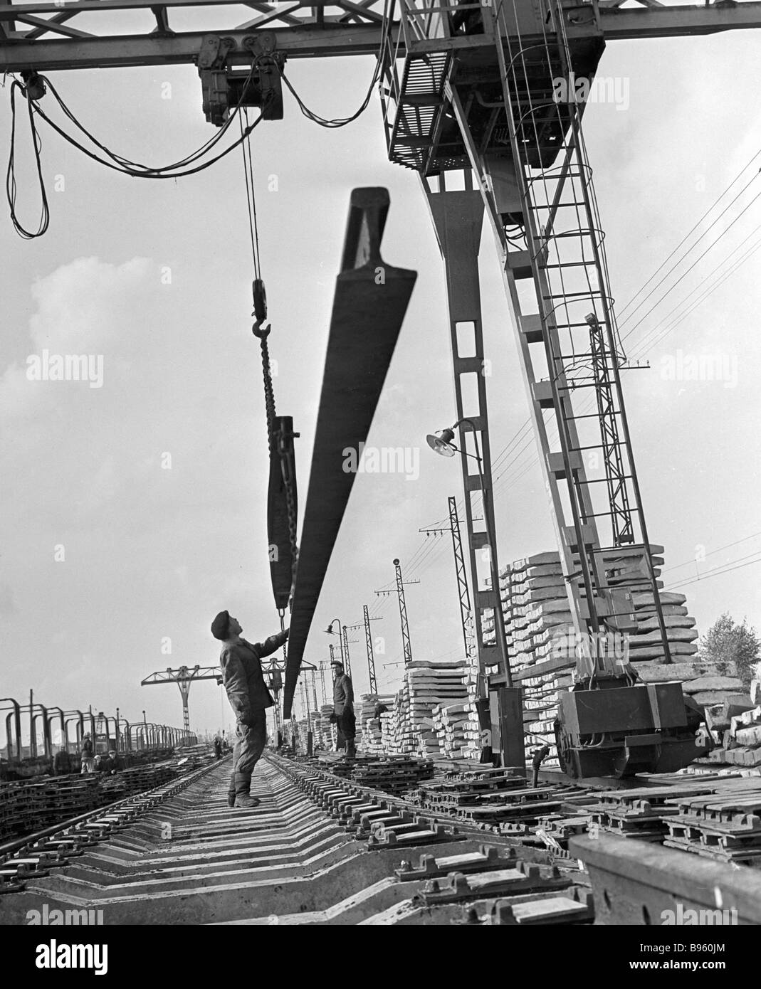 Laying rails on reinforced concrete sleepers on Moscow Railroad - Stock Image