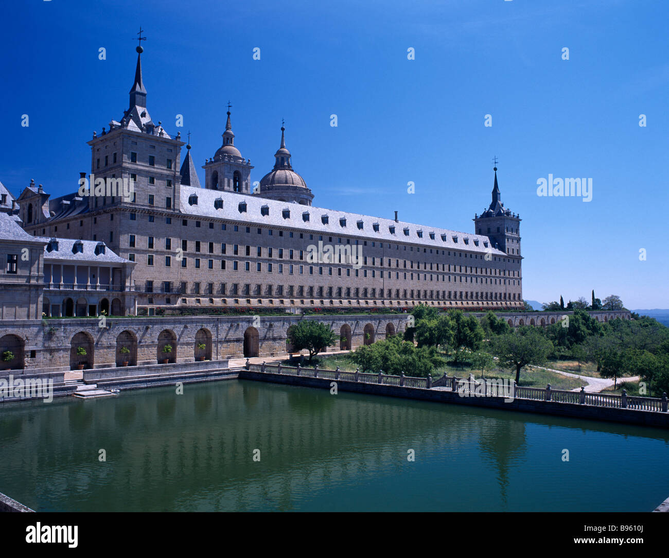 SPAIN Madrid State El Escorial Palace of San Lorenzo de El Escorial seen from the west side with large water pool Stock Photo