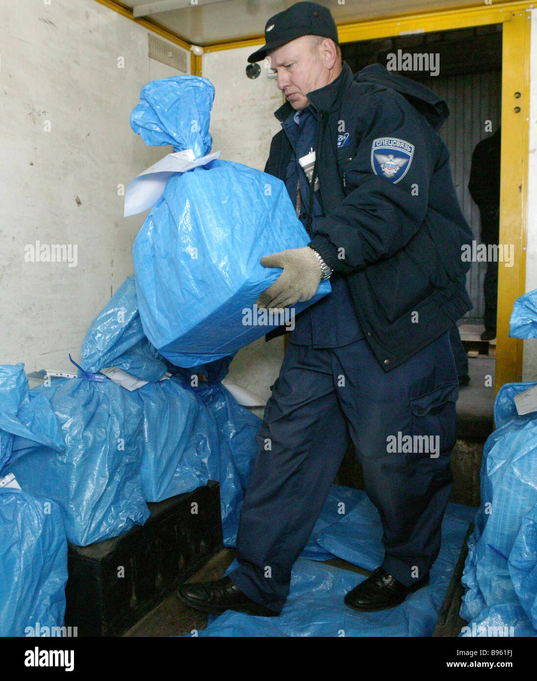 Loading ballots for the Kaliningrad region on special communication lorries On Wednesday the ballots guarded by - Stock Image