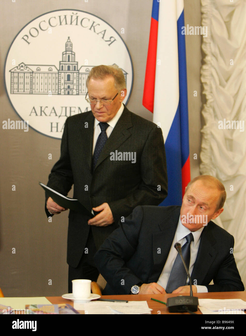From left to right Russia s Academy of Sciences head Yury Osipov and President Vladimir Putin attending the session - Stock Image