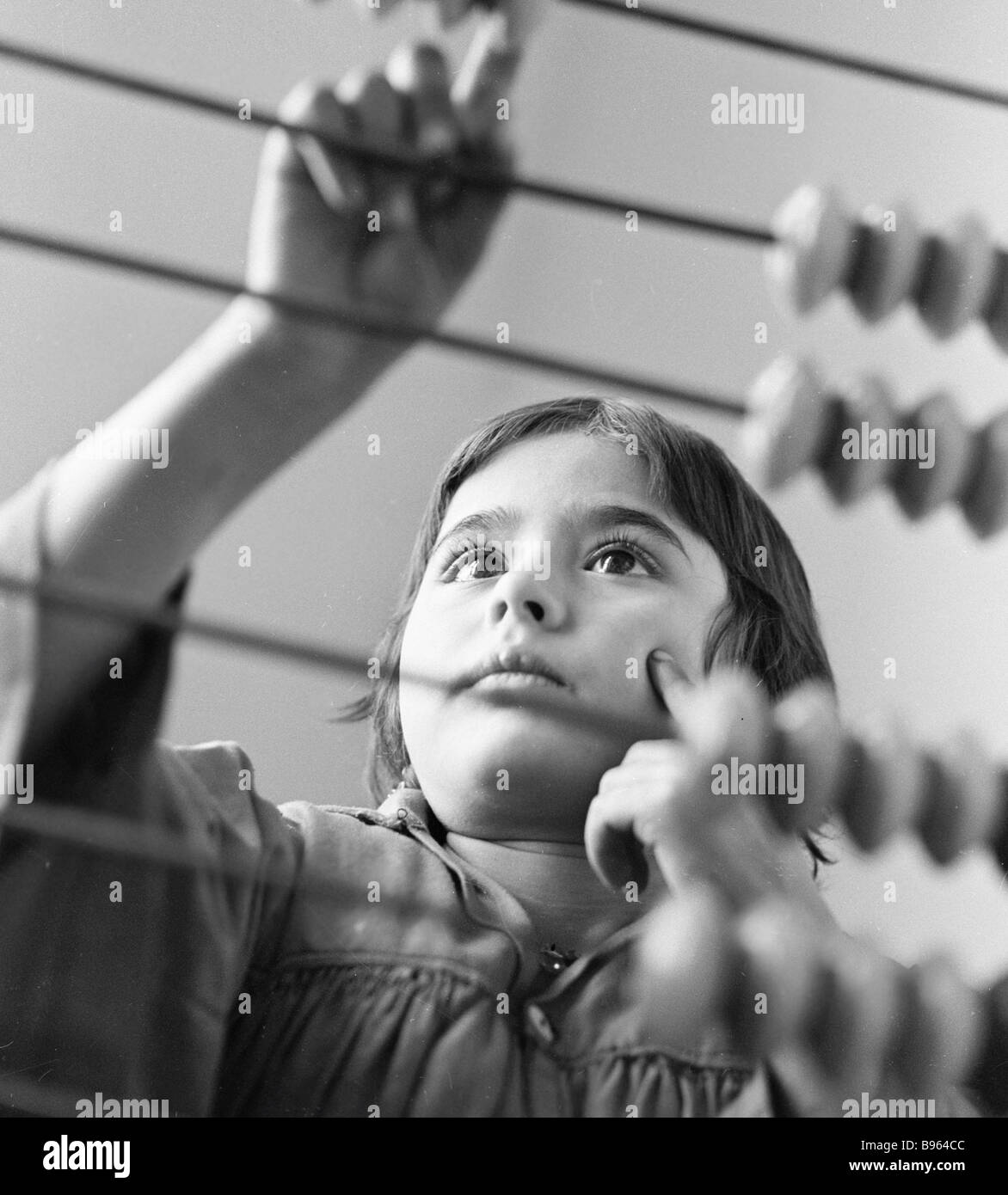 Tajik schoolgirl learning to count - Stock Image