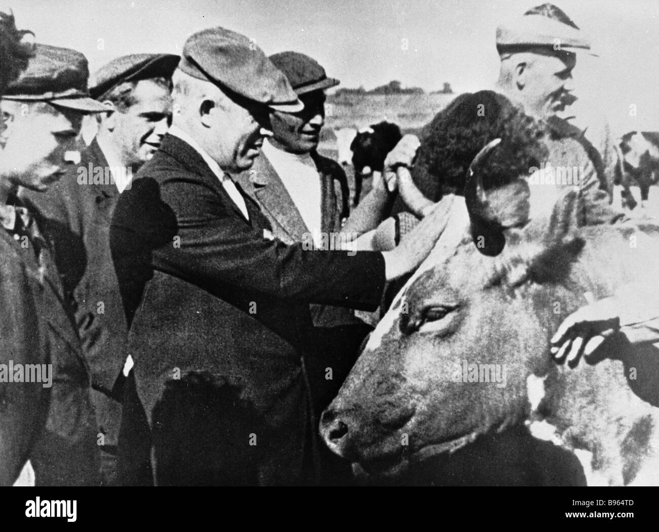 Nikita Khrushchev center discussing stock breeding problems with farmers - Stock Image