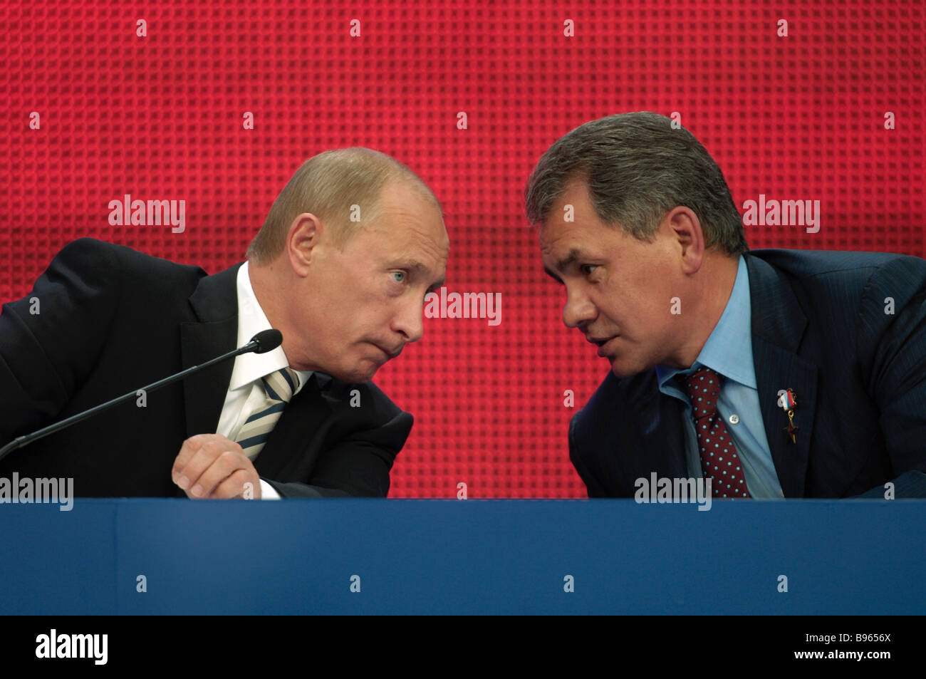 Russian President Vladimir Putin to the left and Emergencies Relief Minister Sergei Shoigu attend the 8th congress - Stock Image