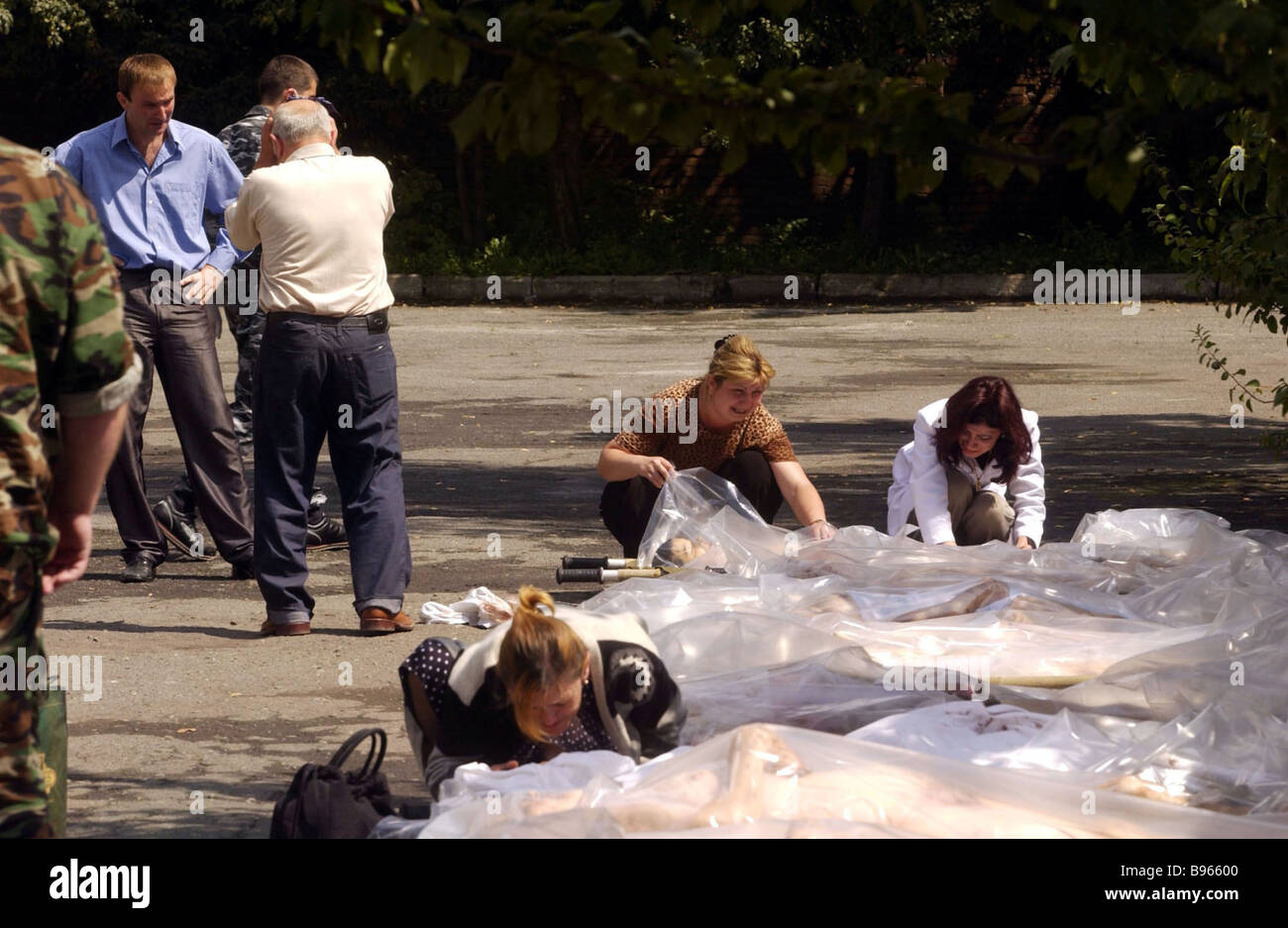 Relatives of people killed by terrorists at Beslan s School No 1 identifying bodies at Vladikavkaz mortuary Stock Photo