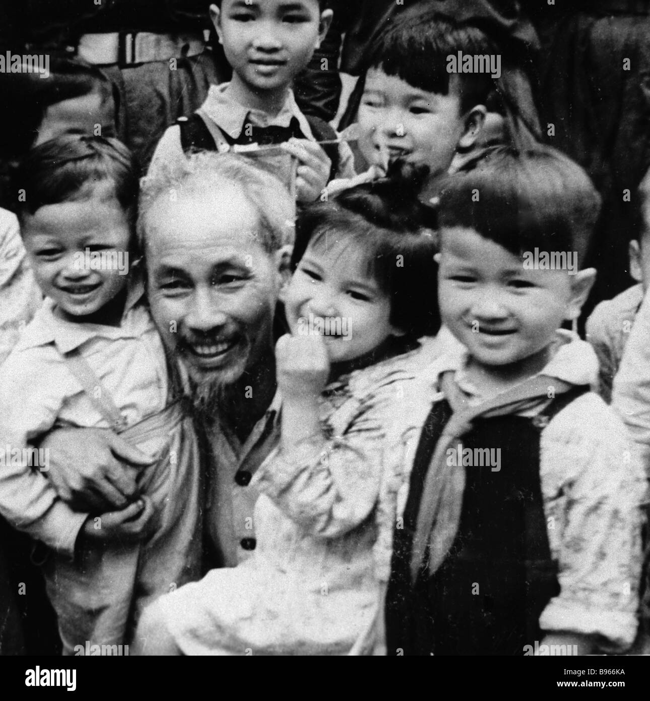 Ho Chi Minh Chairman of the Central Committee of the Vietnam Workers Party center with children - Stock Image