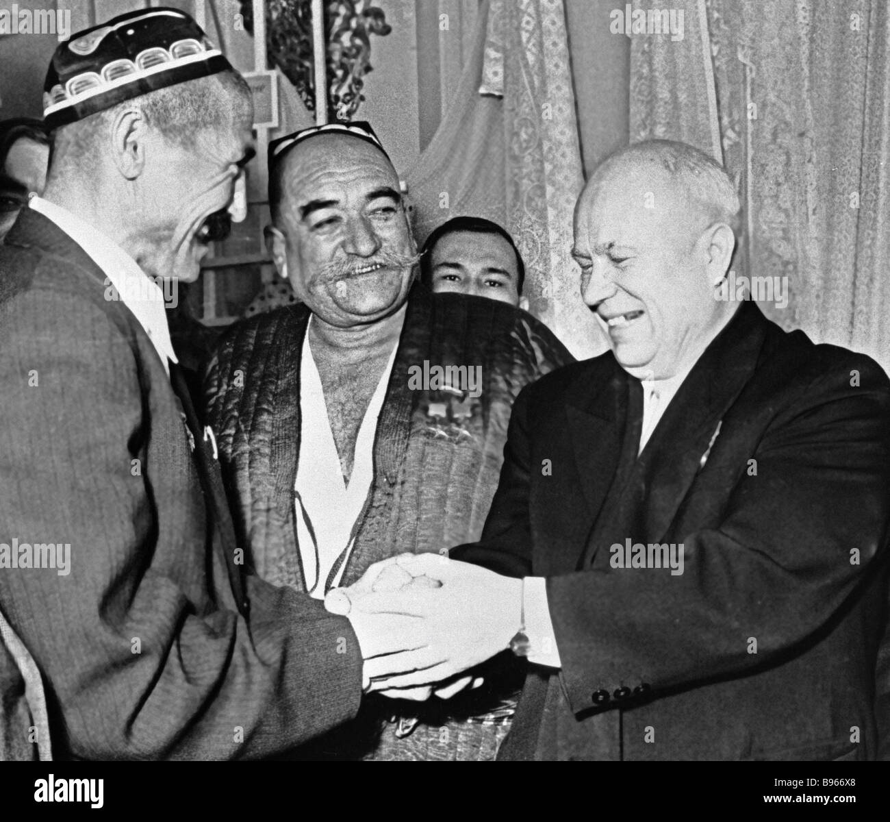 Nikita Khrushchev right greeting Tajikistan collective farm managers - Stock Image