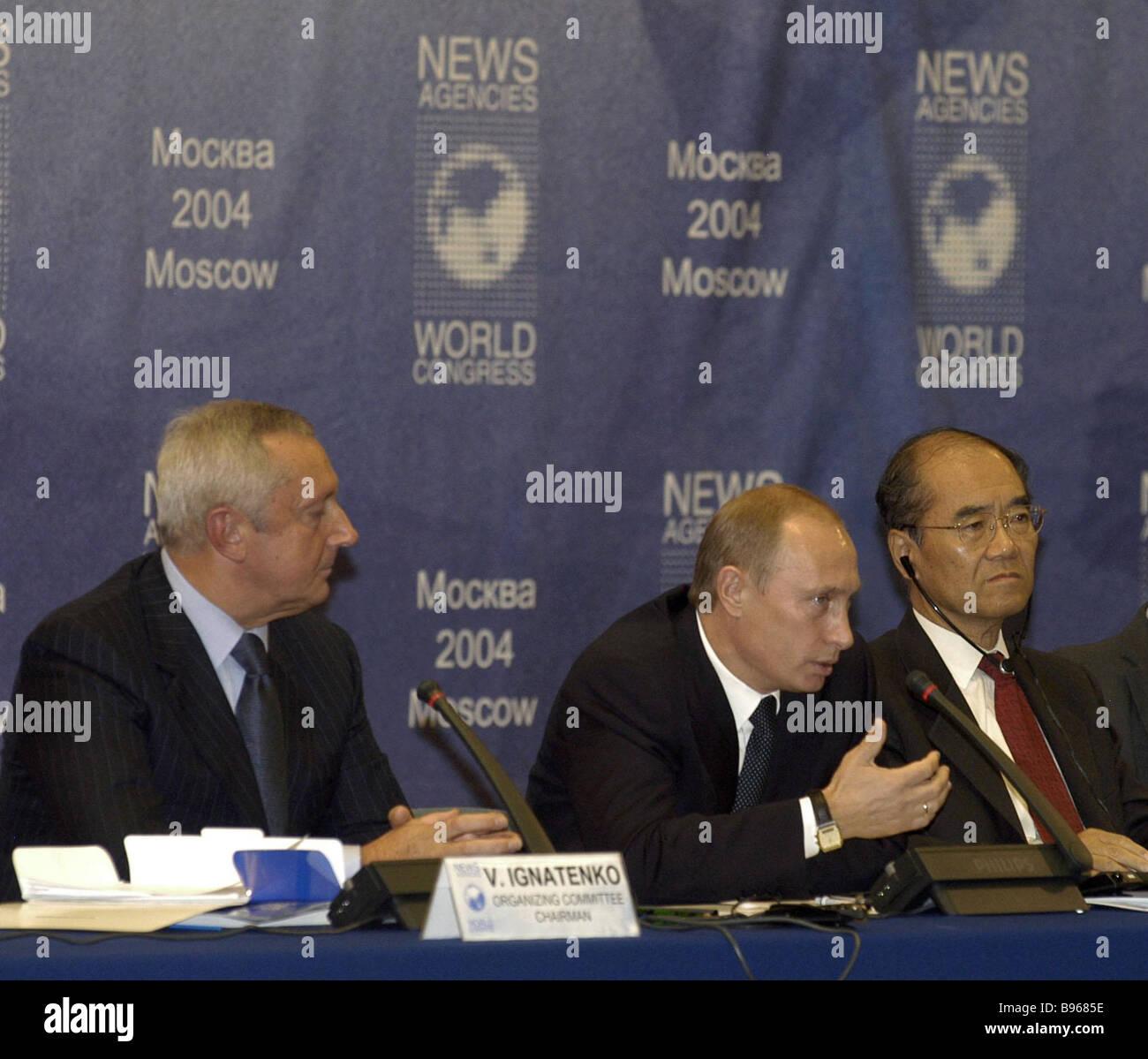 Russian President Vladimir Putin center UNESCO Director General Koichiro Matsuura right and ITAR TASS General Director - Stock Image