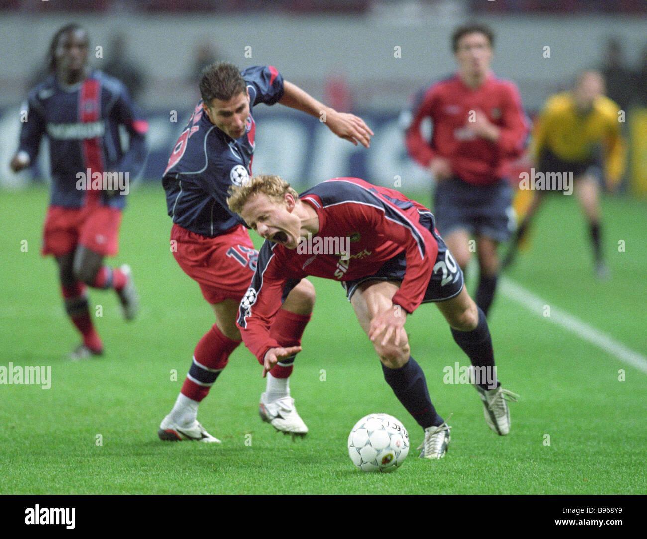 Champion League soccer meet of TsSKA red jerseys and Paris Saint Germain Jarosik TsSKA No 20 has the ball - Stock Image