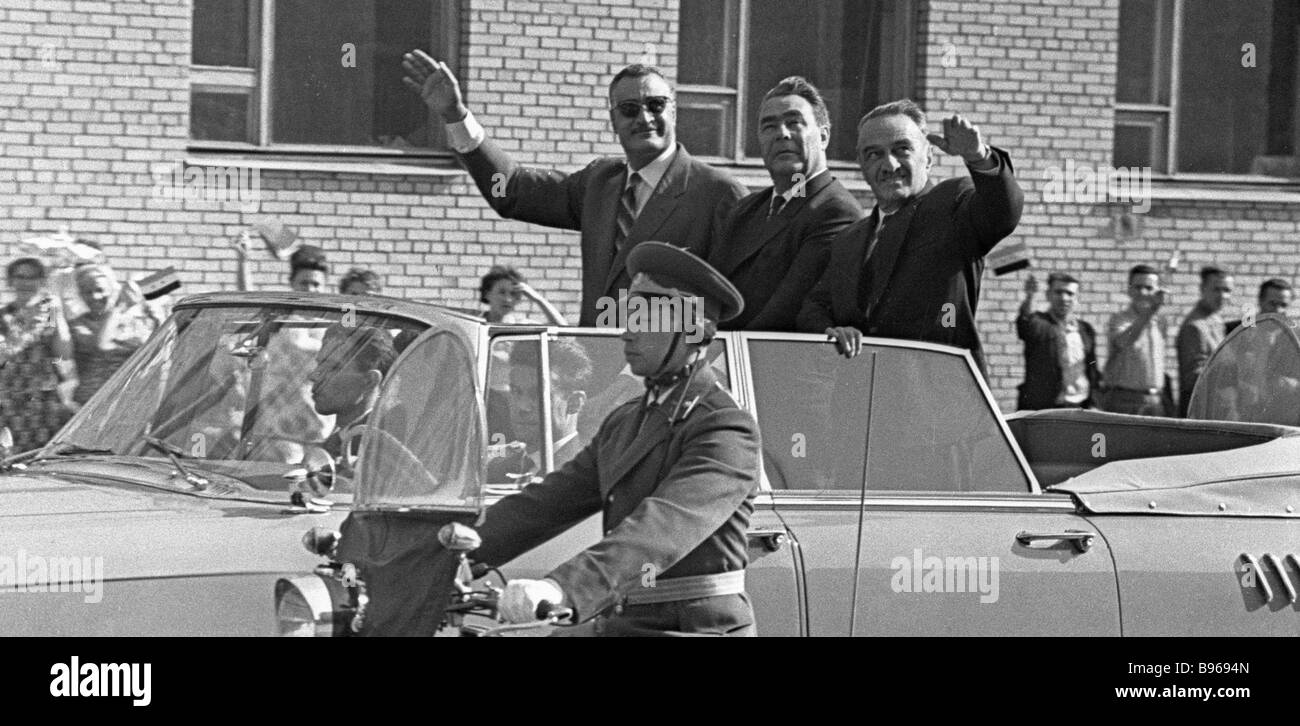 Left to right Gamal Abdel Nasser United Arab Republic President Leonid Brezhnev and Anastas Mikoyan in a limousine - Stock Image