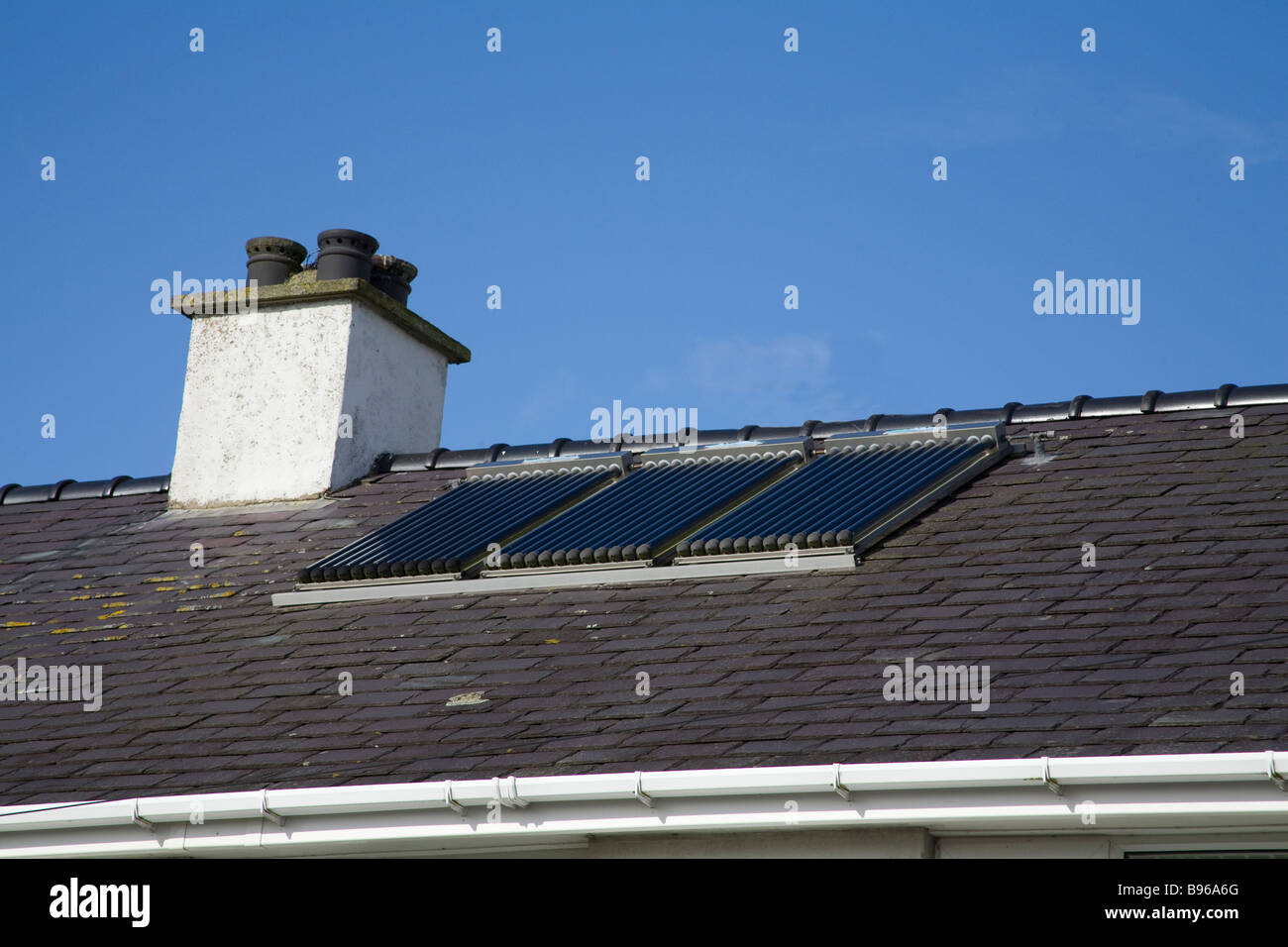 North Wales March A set of three evacuation tube solar panels on the roof of a house to provide cheap renewable Stock Photo
