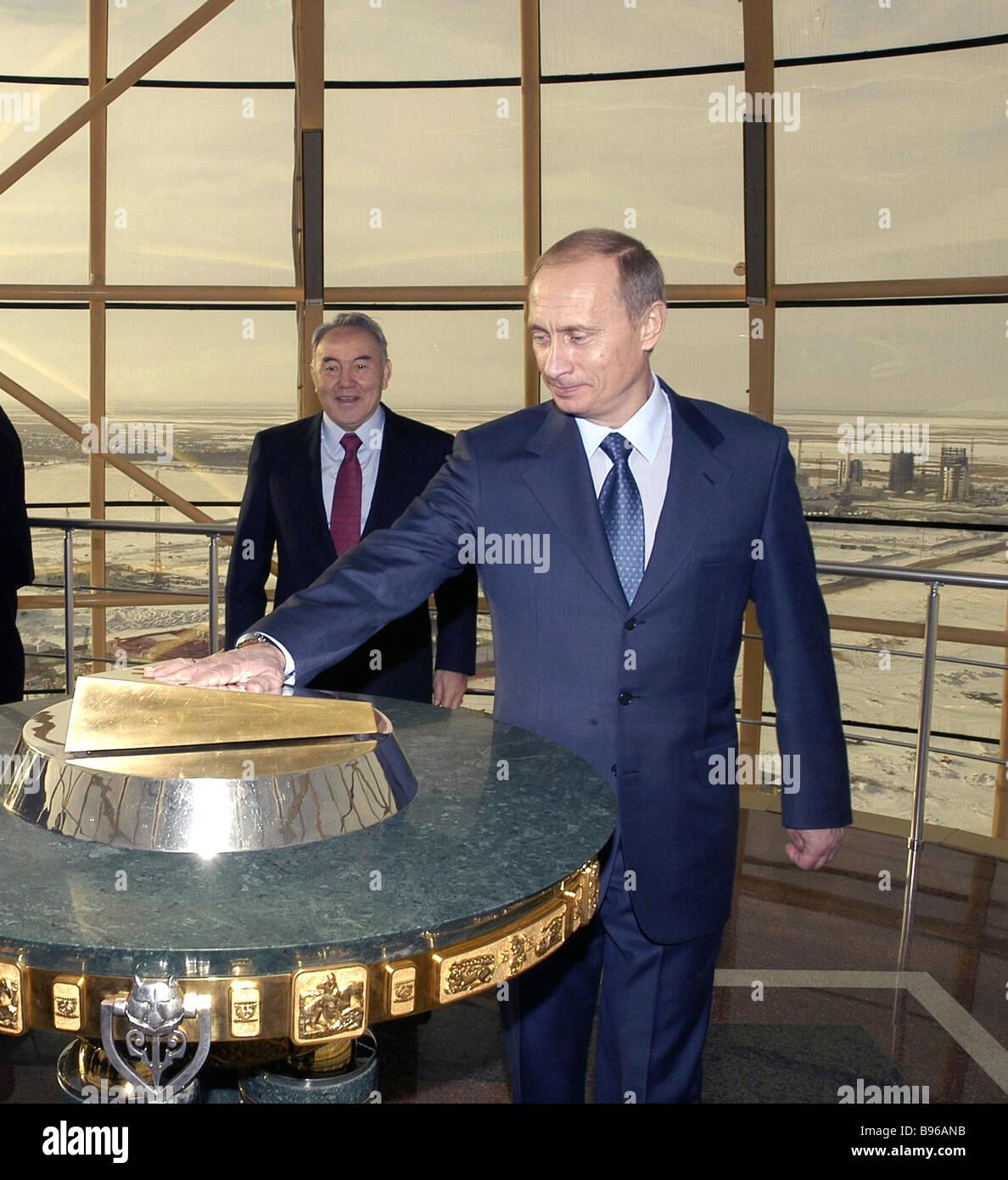 Russian President Vladimir Putin accompanied by Kazakh President Nursultan Nazarbayev admires monument Astana Baiterik - Stock Image