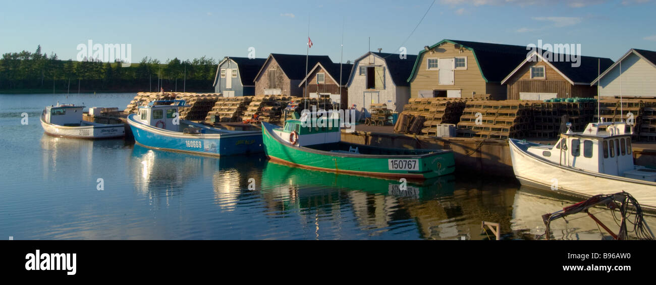 Panorama Boats in harbor with lobster traps stacked New London Prince Edward Island Canada Stock Photo