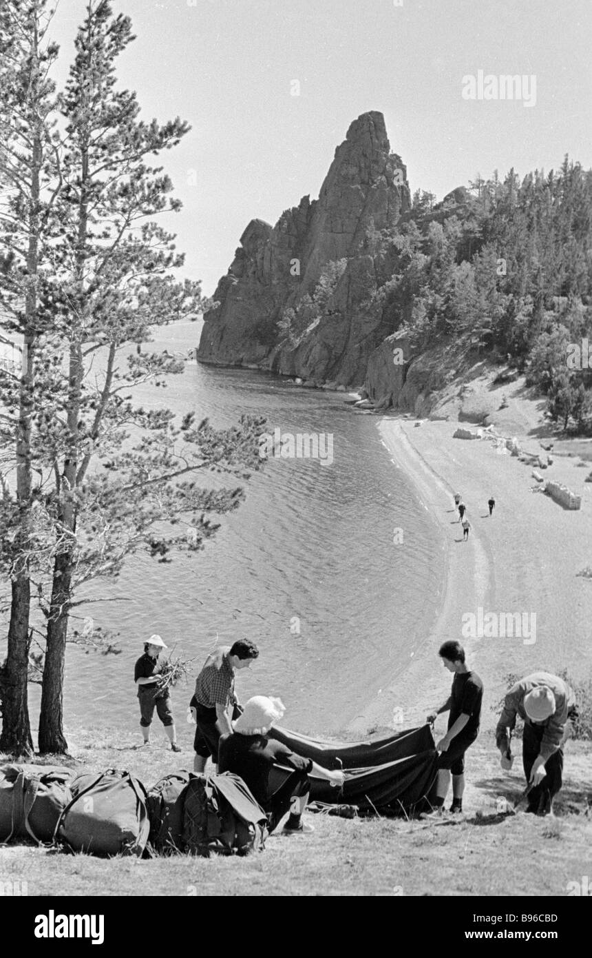 Tourists pitch up tents on the shore of Lake Baikal - Stock Image