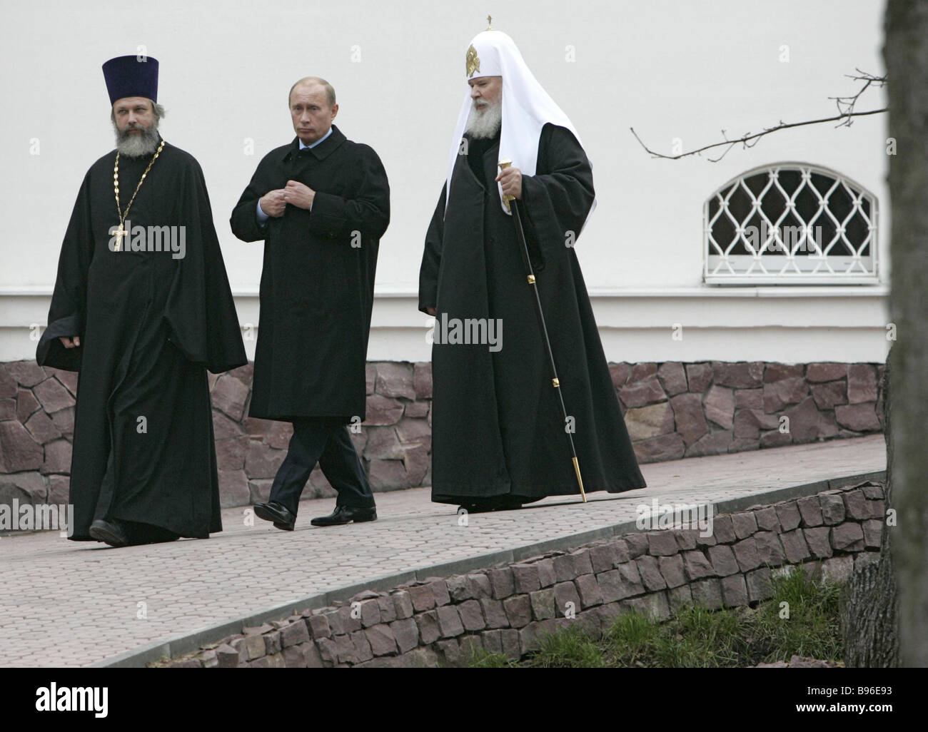 From left to right Rev Kirill Kaleda rector of the Church Russian President Vladimir Putin and Patriarch of All - Stock Image