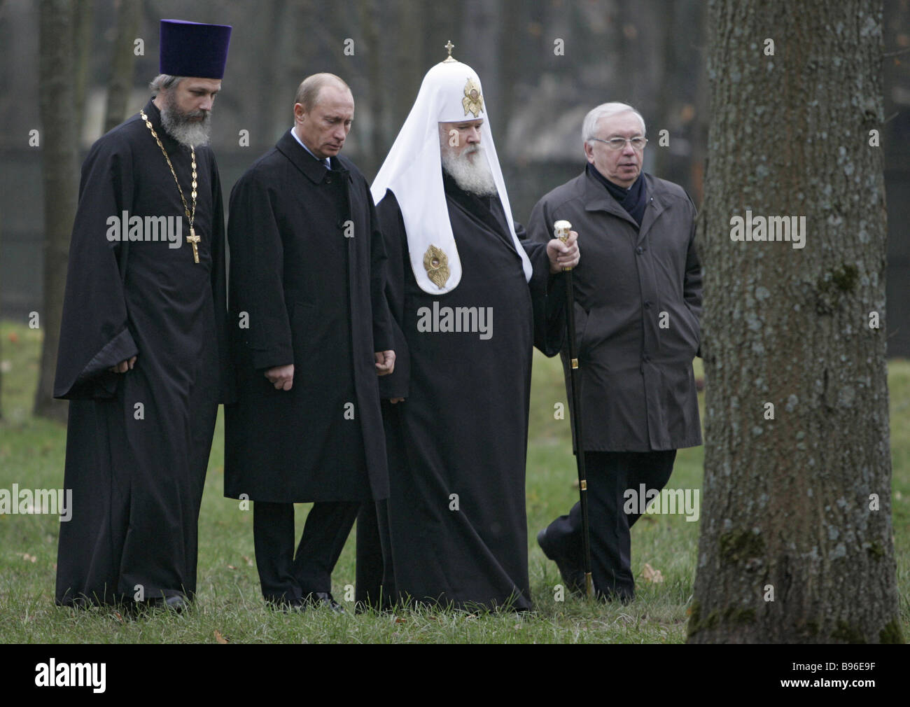 From left to right Rev Kirill Kaleda rector of the Church Russian President Vladimir Putin Patriarch of Moscow and - Stock Image