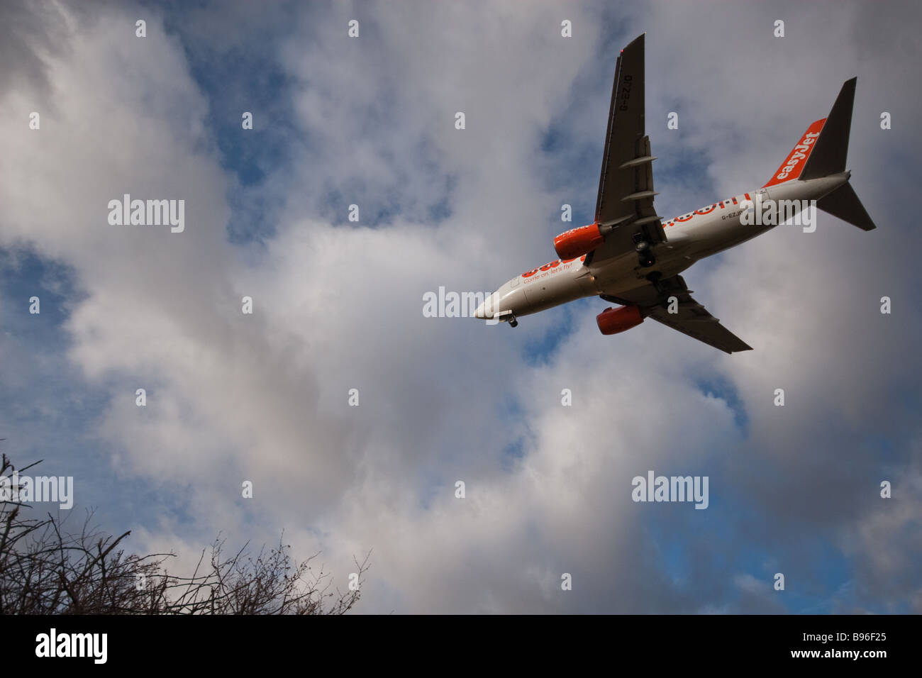 Easyjet Aircraft landing at Luton Airport - Stock Image