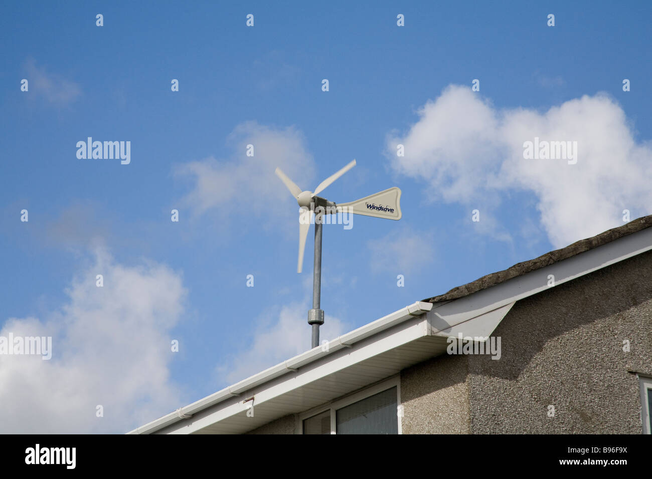 UK  March A small wind turbine on a domestic house to provide cheap energy - Stock Image