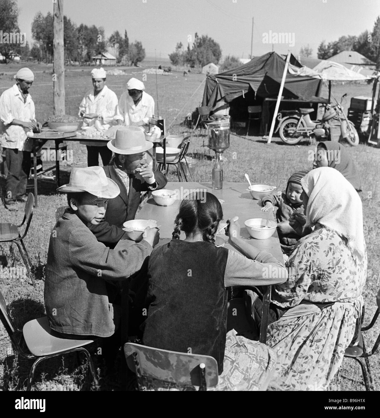 Tyupsky district inhabitants living in a tent camp after the June 1970 earthquake dine at a field mess hall - Stock Image