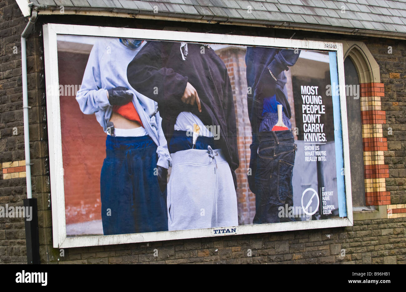 Titan billboard site advertising campaign to stop knife crime amongst young people on side of building in Treorchy - Stock Image