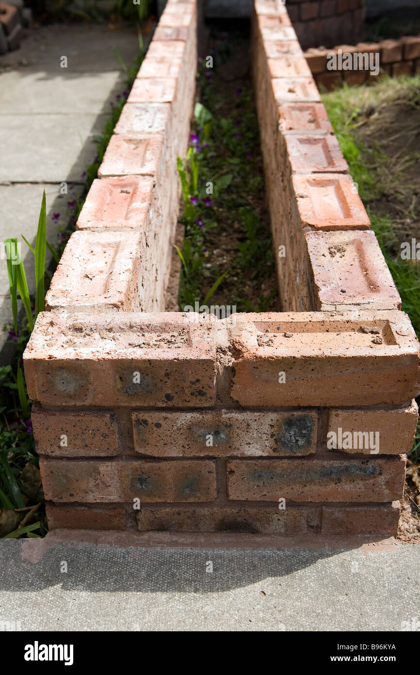 Merveilleux Small Brick Wall That Is To Be Used As A Raised Bed In A Garden