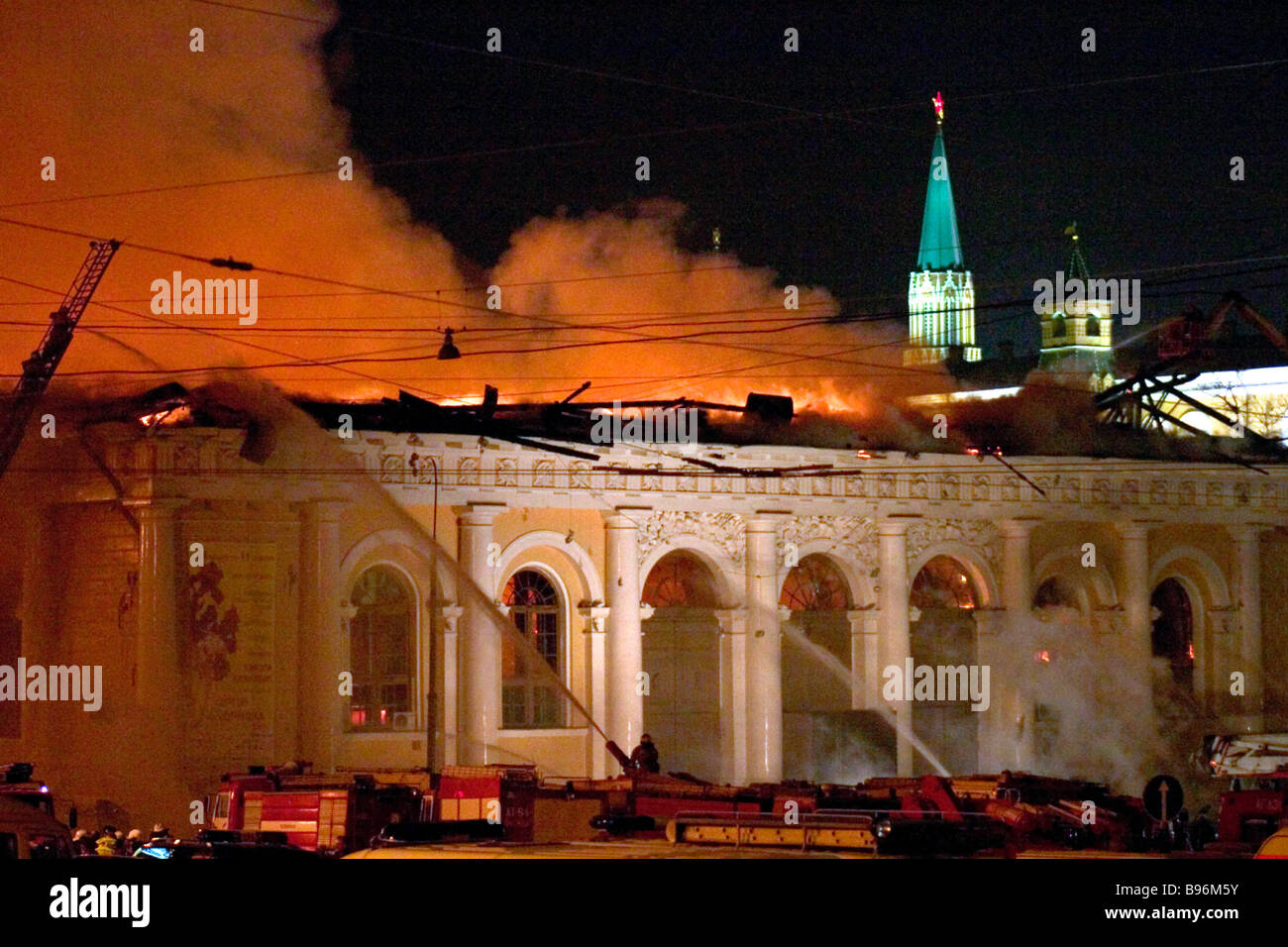Sixty fire fighting teams tried to extinguish blaze in the Moscow based Manezh building - Stock Image