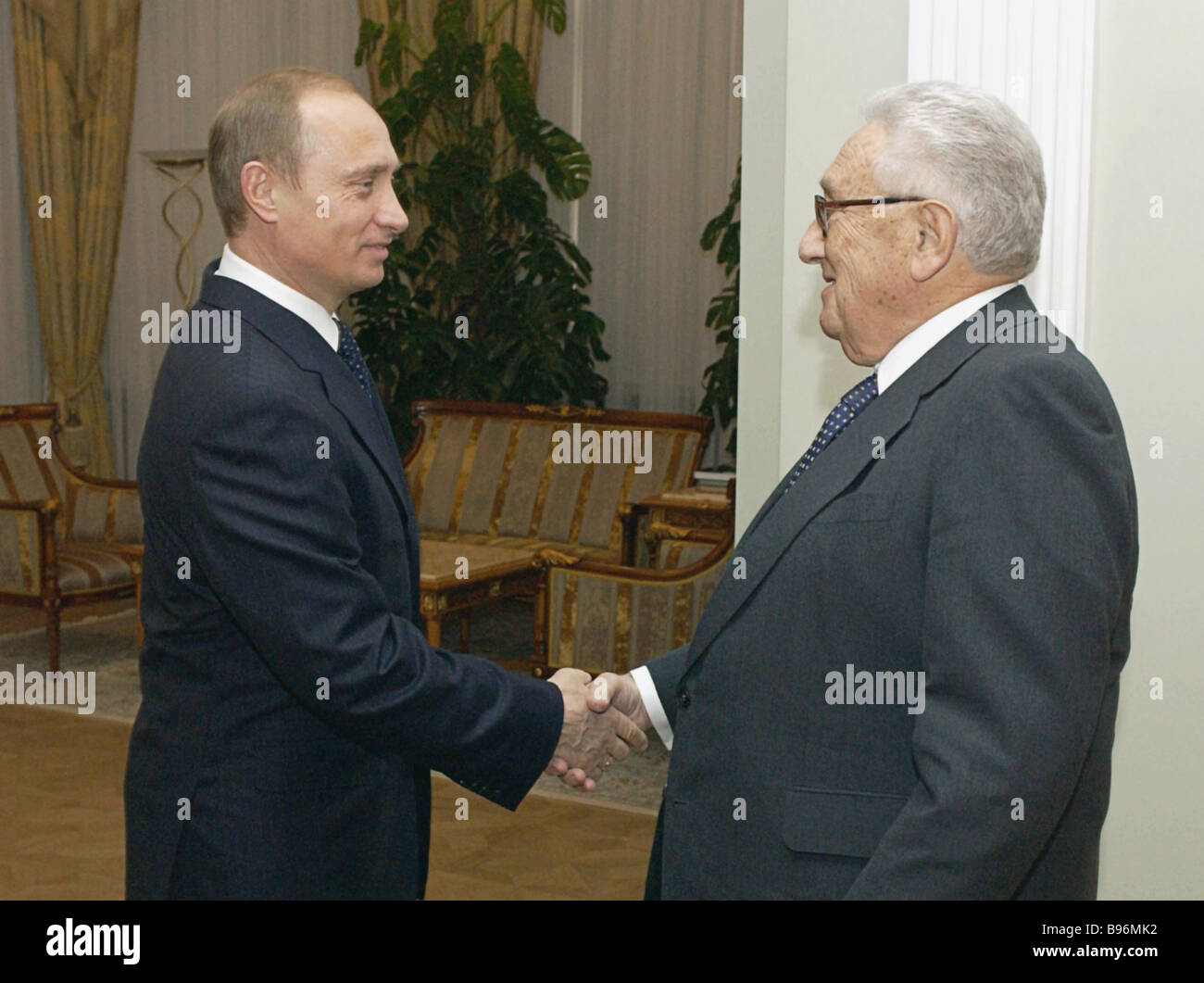Russia President Vladimir Putin during a meeting with Henry Kissinger famous American politician and former Secretary - Stock Image