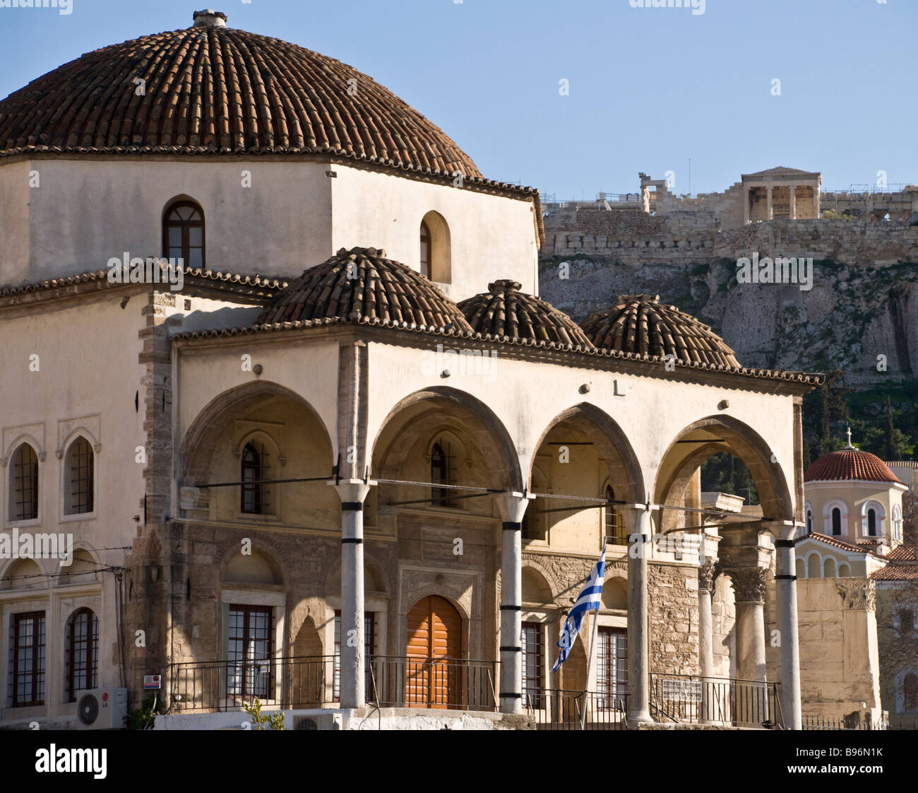 Looking up from theTzisdarakis mosque in Monastiraki square towards the hill of the Acropolis, Plaka, Central Athens, - Stock Image