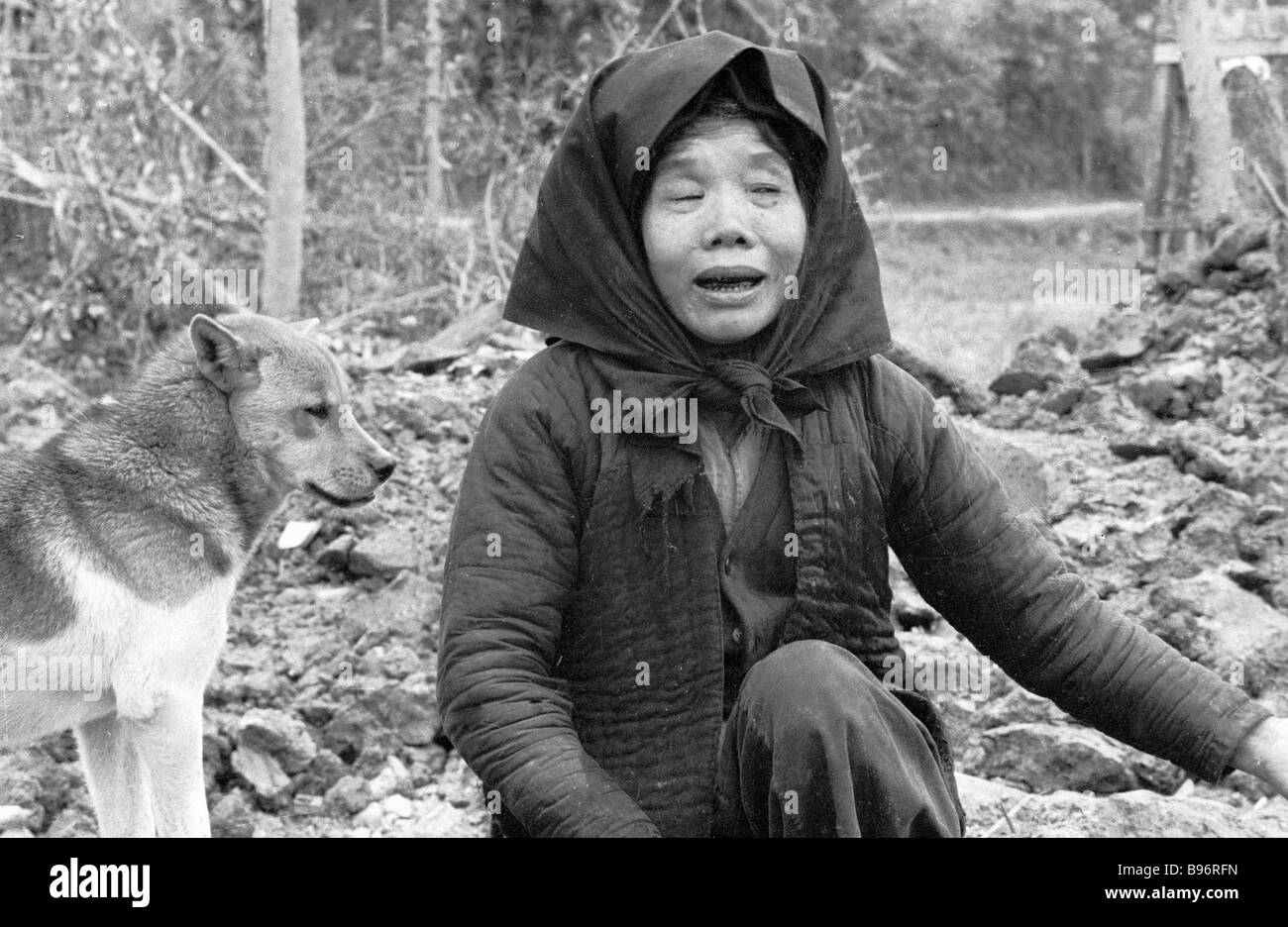 A Vietnamese woman who lost her entire family in the war - Stock Image