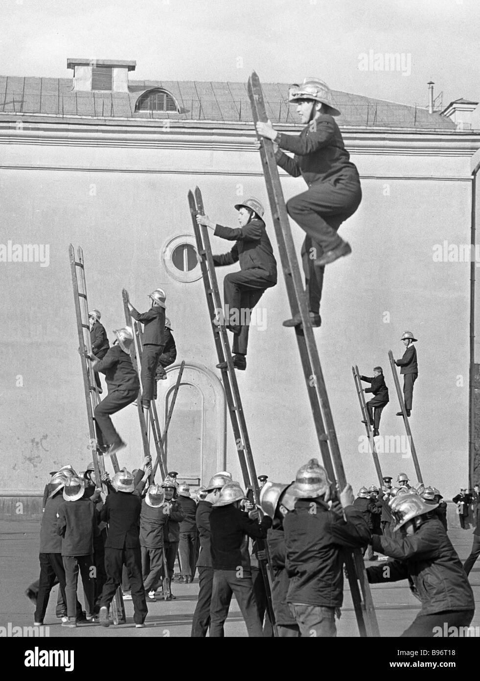 Young firemen brigade on training - Stock Image