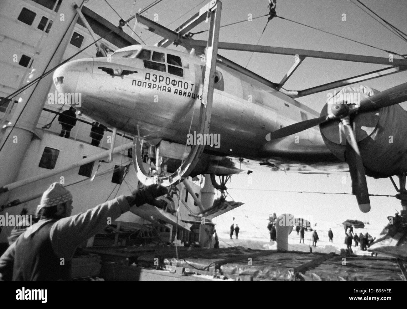 Polar aviation plane removed from ship in the Antarctic - Stock Image