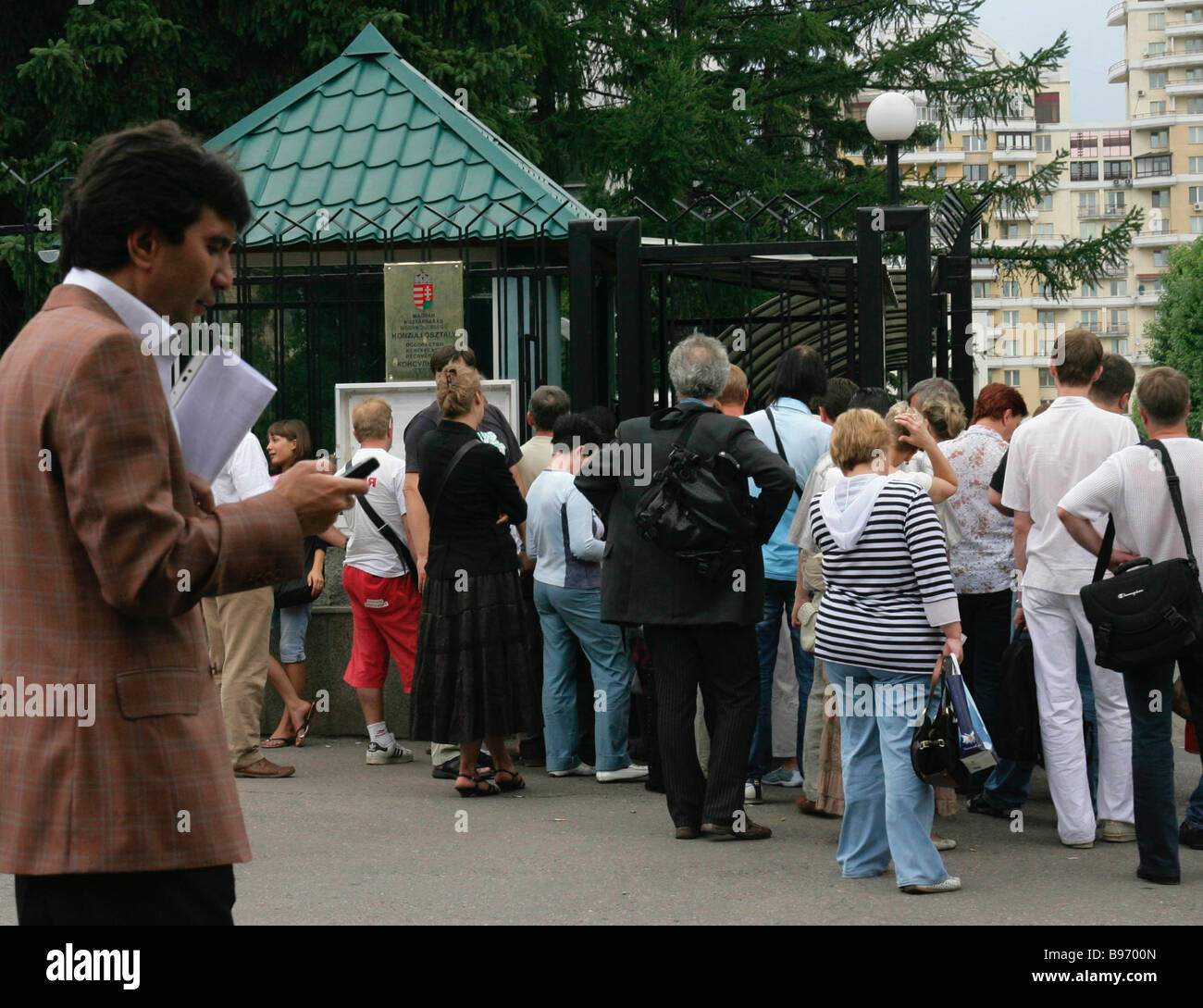 Russian citizens lining up to get visas at the consular department of the Hungarian embassy in Moscow - Stock Image