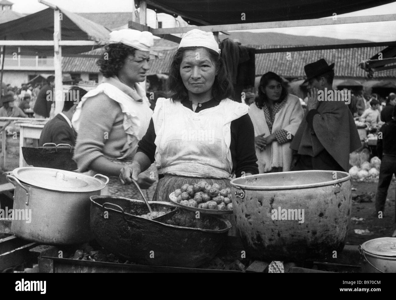 A market woman plying her wares - Stock Image