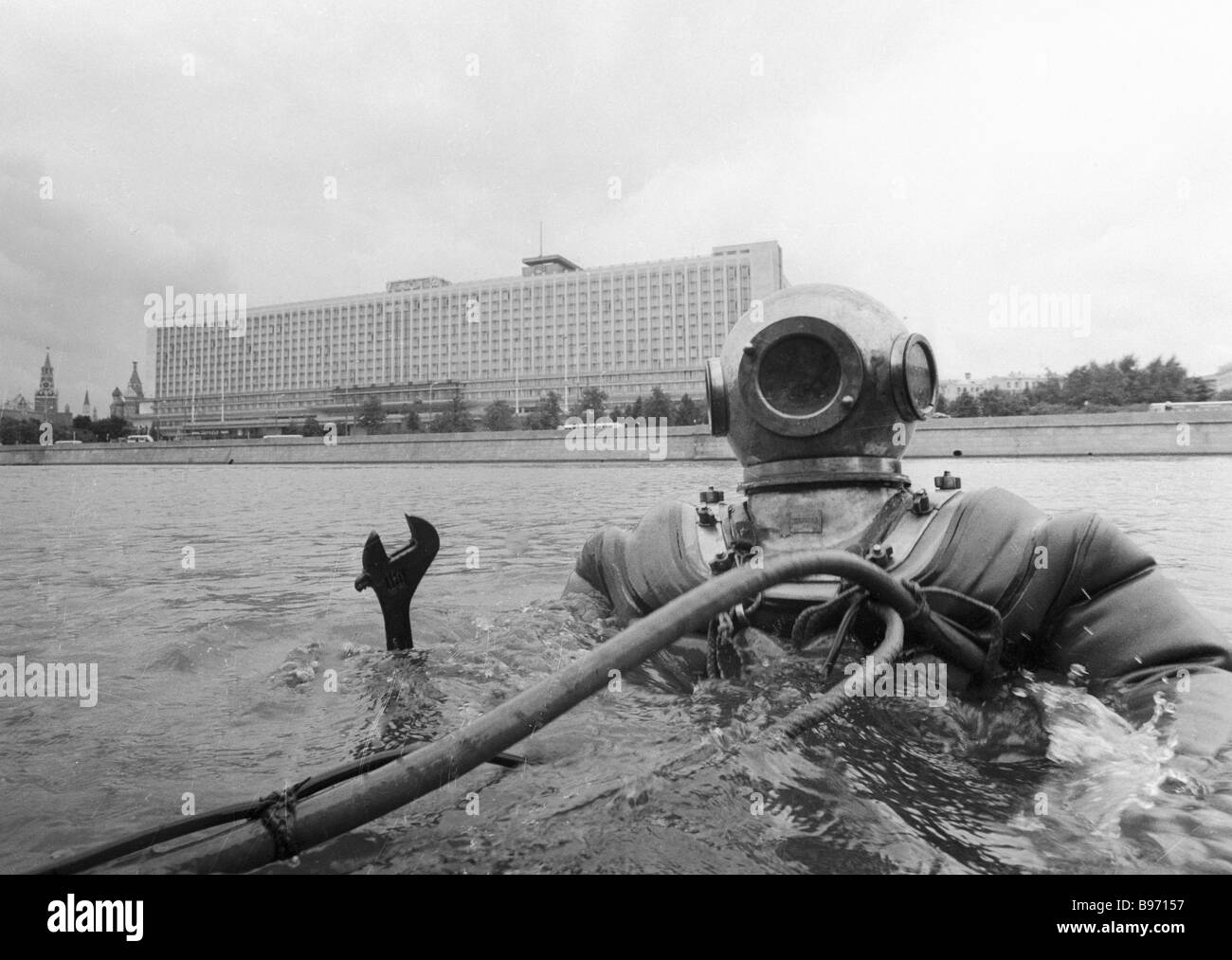Diver inspecting underwater facilities of the city water supply system and sewage - Stock Image