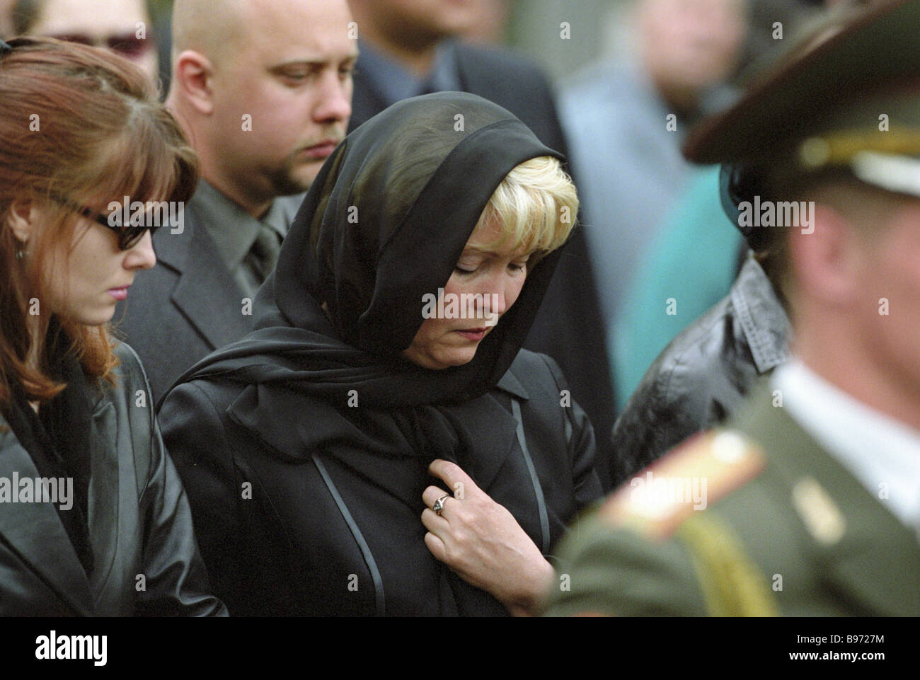 Inna Lebed center widow of the Krasnoyarsk region governor General Alexander Lebed at the funeral ceremony - Stock Image