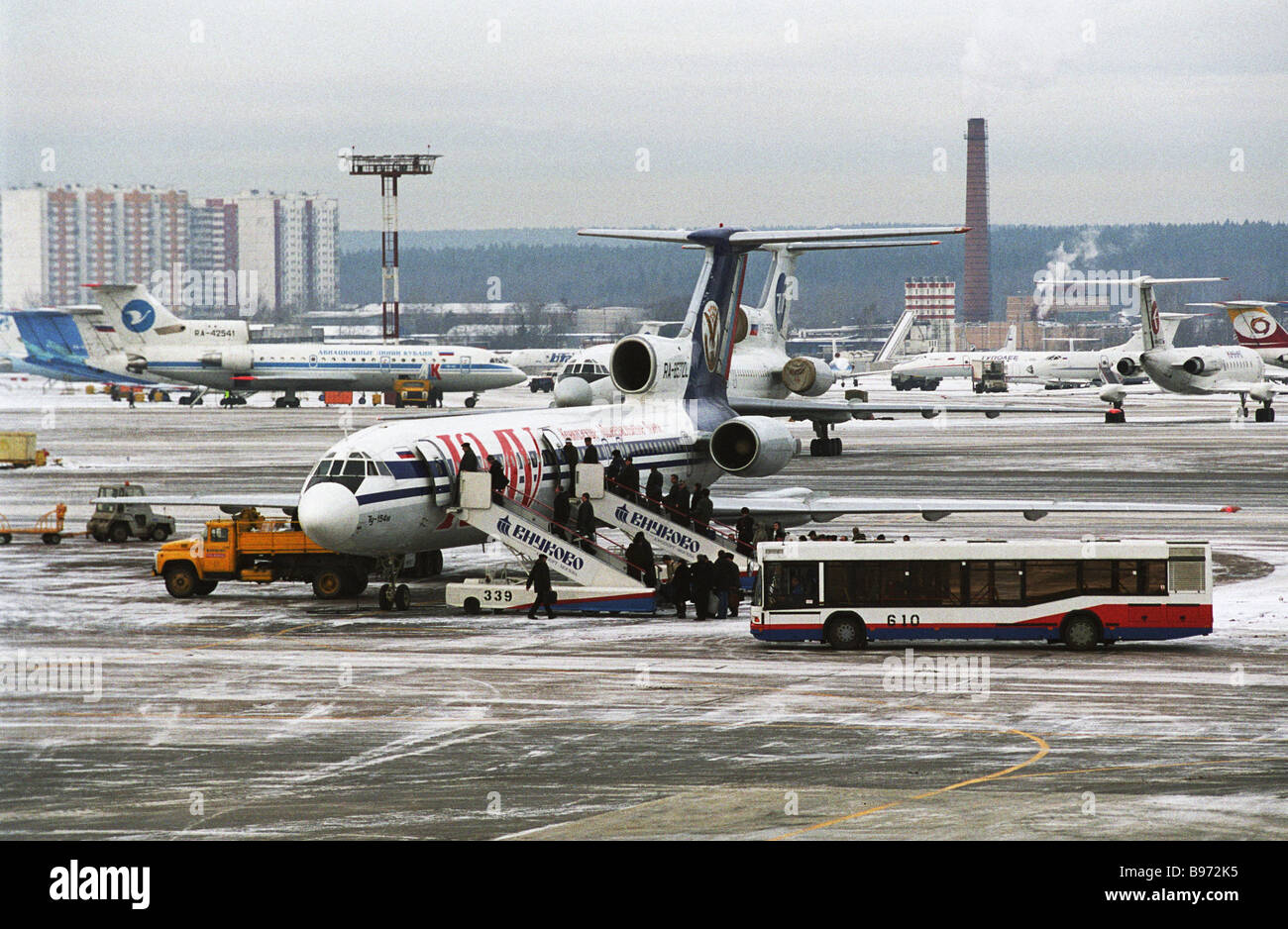 Passengers boarding an airliner at Vnukovo International Airport - Stock Image
