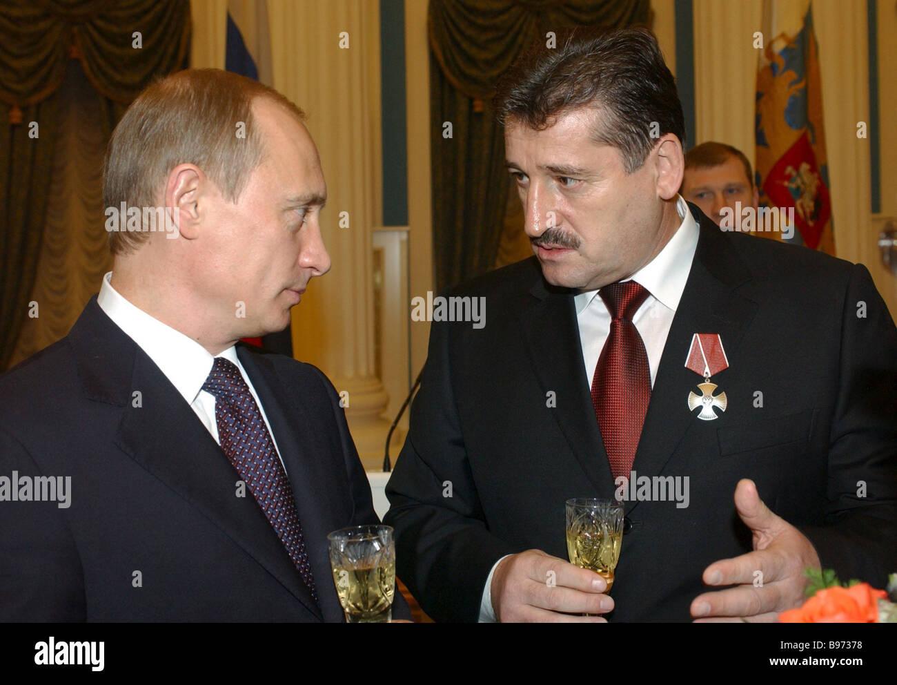 Russian President Vladimir Putin left and Chechen President Alu Alkhanov right in the Kremlin after the state awards - Stock Image