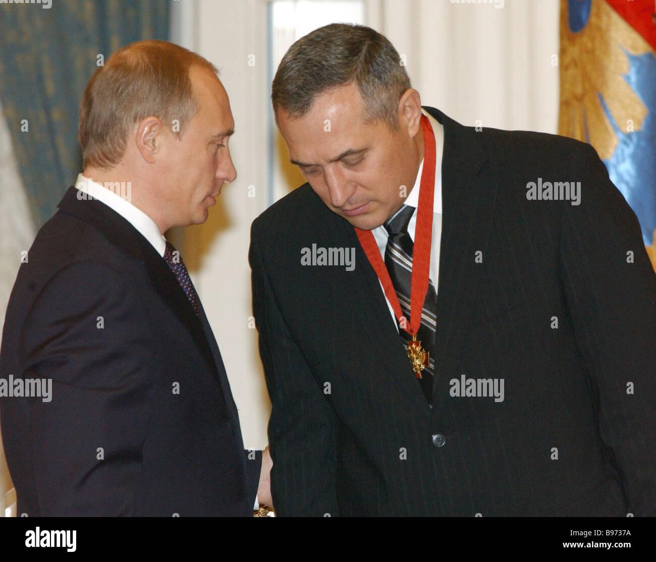 Russian President Vladimir Putin left awards the Order of Merit 3 rd grade to the Presidential envoy to the Siberian - Stock Image
