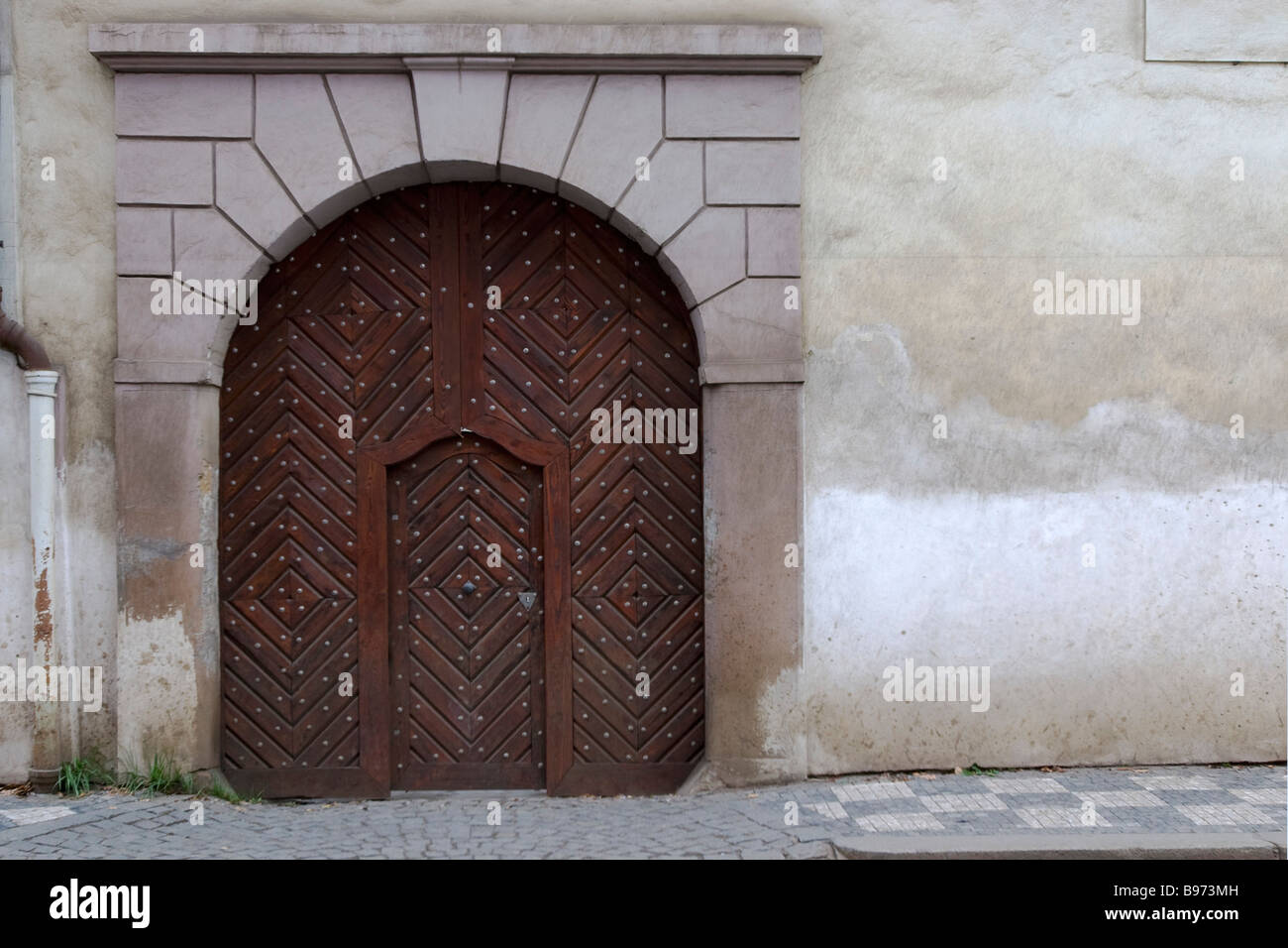 Big arched medieval house door with wicket gate inside it in Prague Czech Republic. & Big arched medieval house door with wicket gate inside it in Prague ...