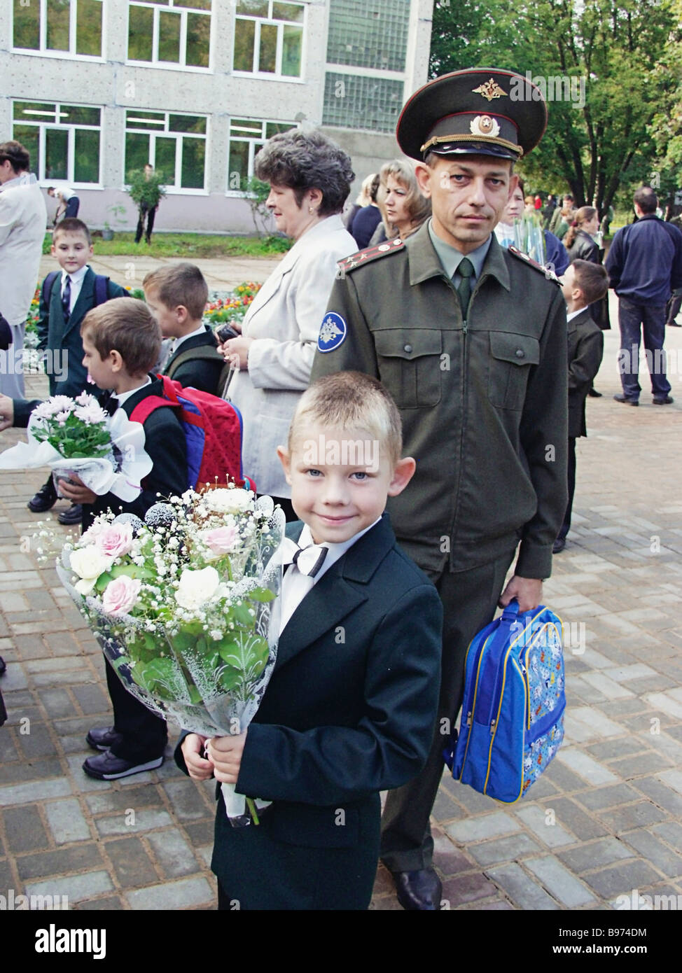 As schoolboy at school No 23 in Balashikha with his father an officer on the first day of the school year - Stock Image
