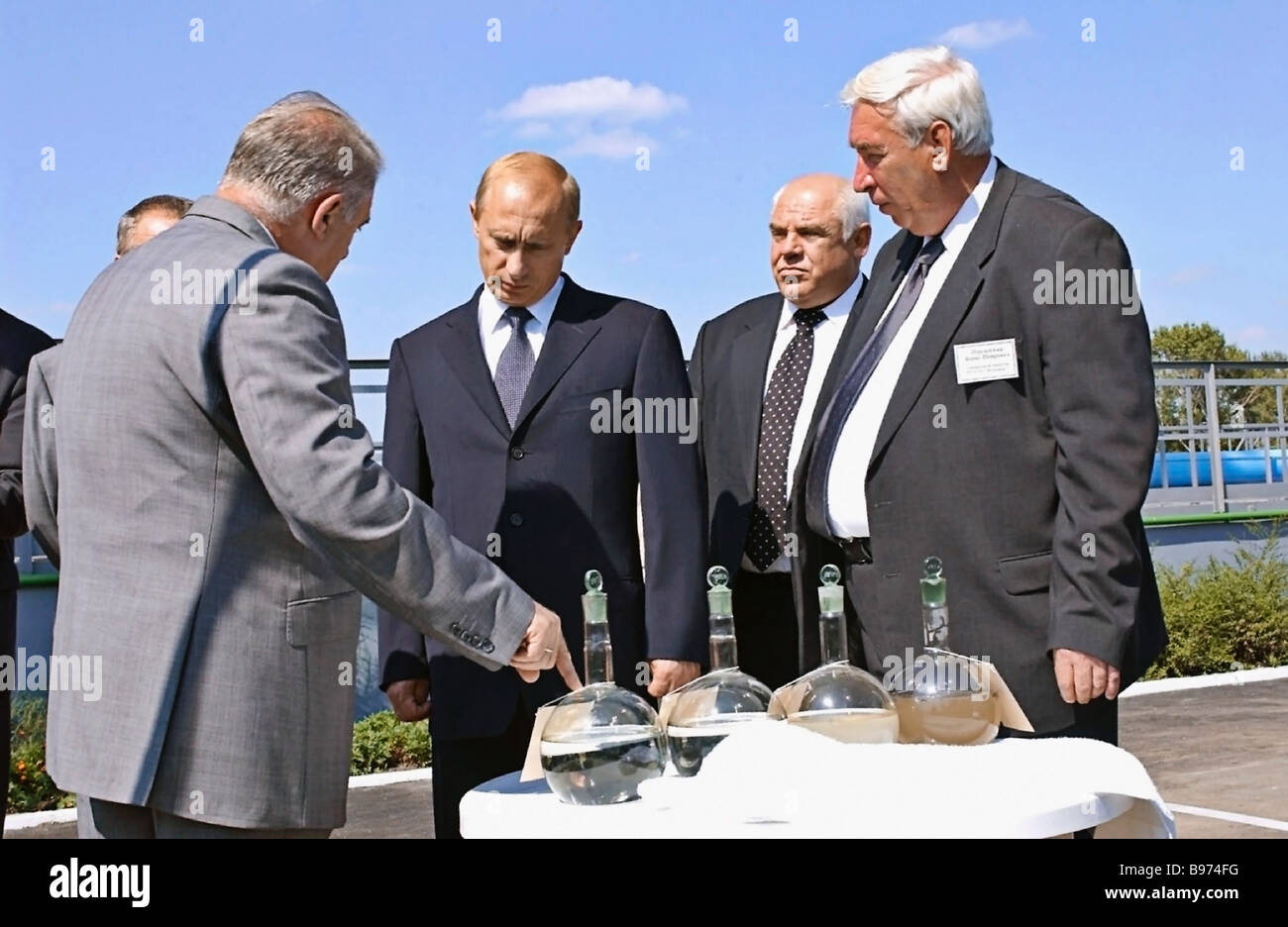 Russian President Vladimir Putin center who visited purification faclities in Rostov On Don was accompanied by Ivan - Stock Image