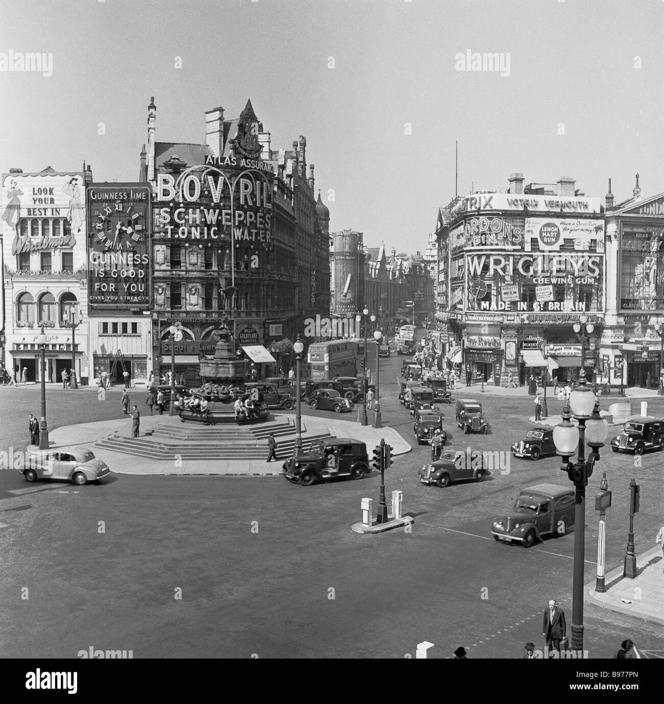 View of an iconic British tourist attraction, Piccadilly Circus, West End, London W1J, taken in 1950s by J Allan - Stock Image