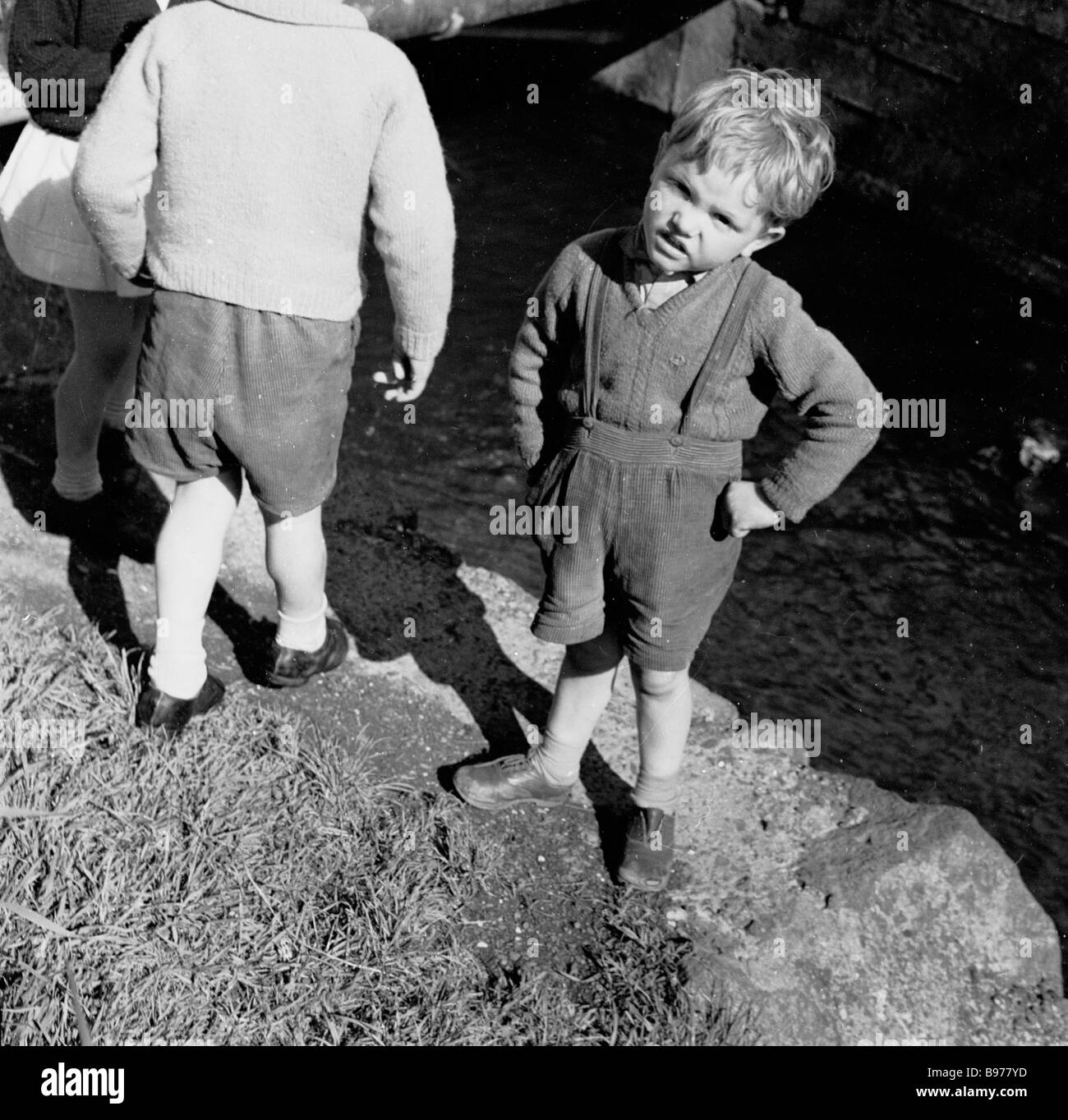 Little boy wearing shorts with braces hands on hips giants causeway northern ireland