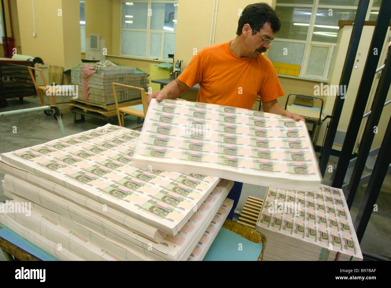 Sorting sheets of 100 ruble bills at Moscow s Goznak printing factory Stock Photo