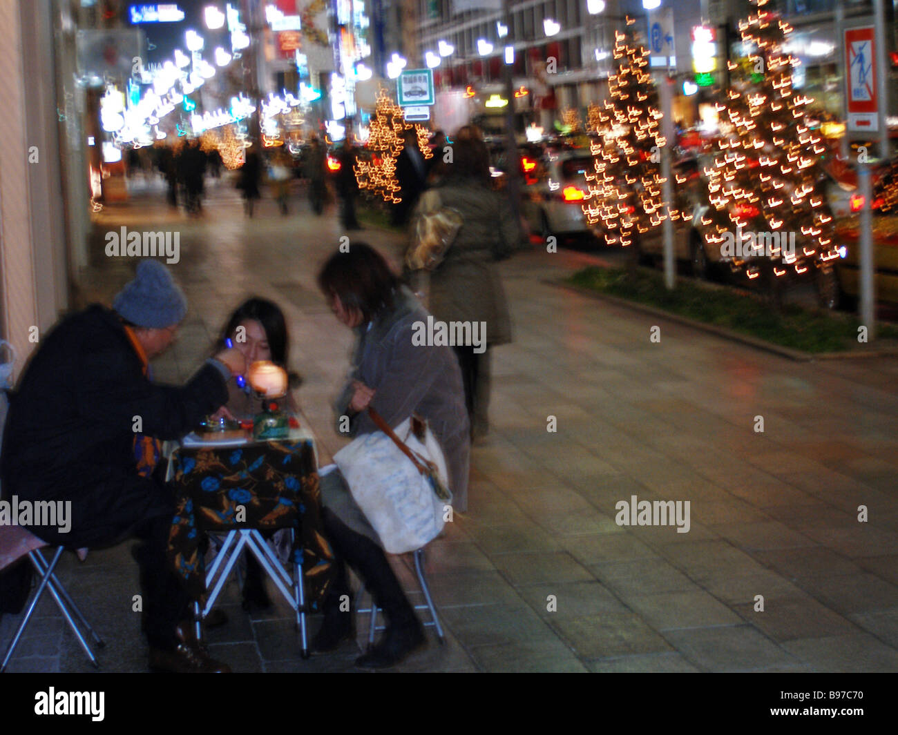 Christmas Eve fortune telling in Ginza Tokyo - Stock Image