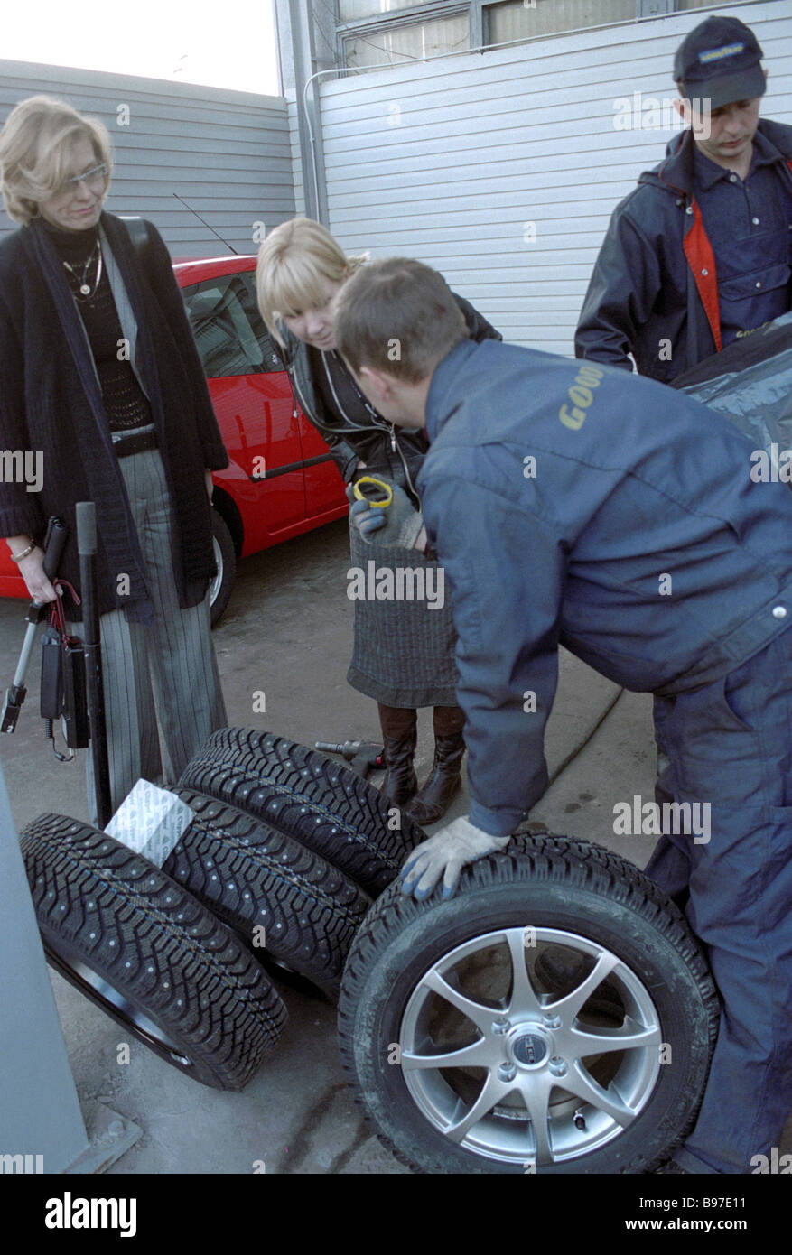 Buying winter tires at a Moscow motor spare parts shop - Stock Image