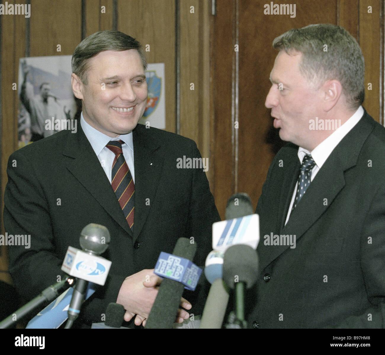 Acting Prime Minister Mikhail Kasyanov left and Duma Vice Speaker Vladimir Zhirinovsky right facing reporters - Stock Image