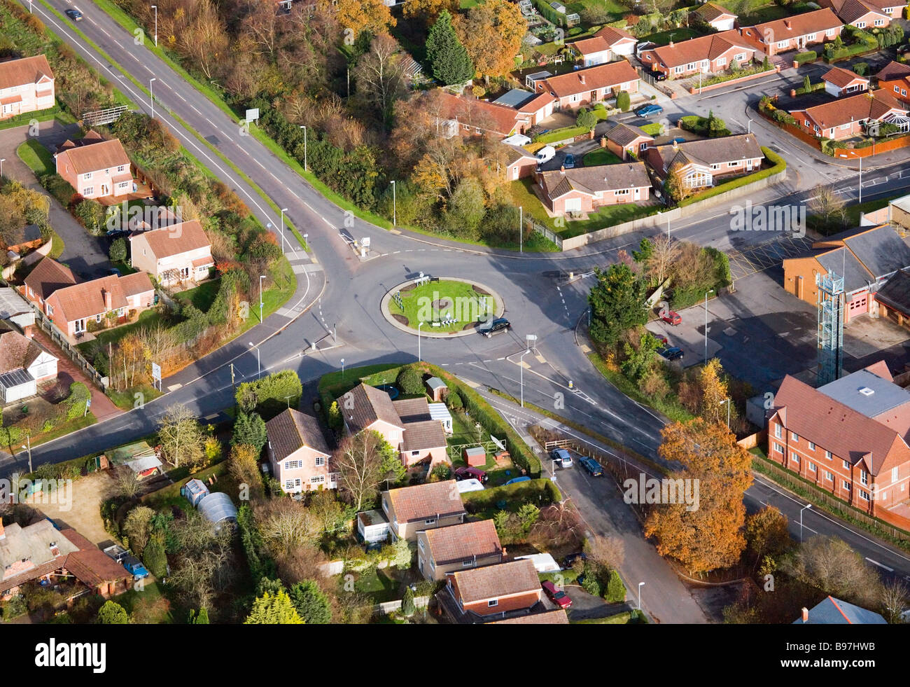 Aerial view showing a roundabout junction. Verwood, Dorset, UK. - Stock Image