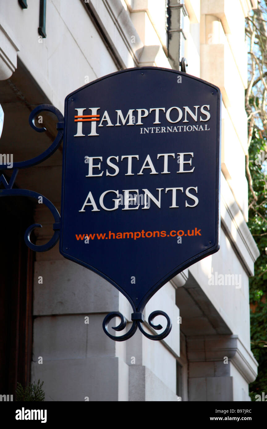 As sign above the entrance to Hamptons Estate Agents, Lower Sloane Avenue, London. March 2009 - Stock Image