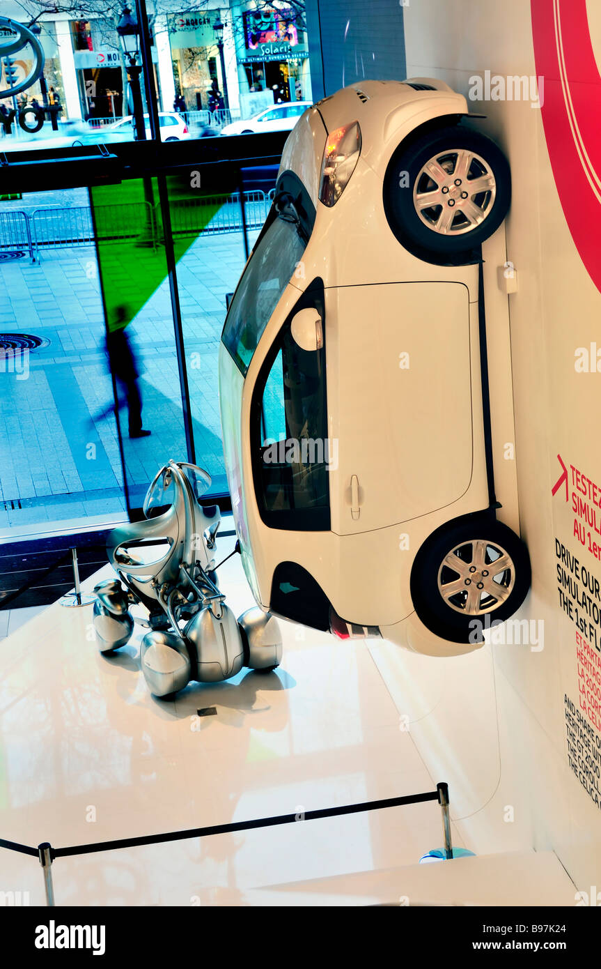 """Paris France, Toyota """"I.Q"""" Car on Display on Wall in """"New Car Store"""" on """"Champs Elysees"""" with """"I Unit"""" """"Concept Stock Photo"""
